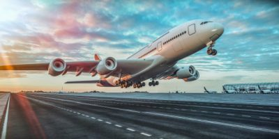 airplane-taking-off-from-airport_37416-74